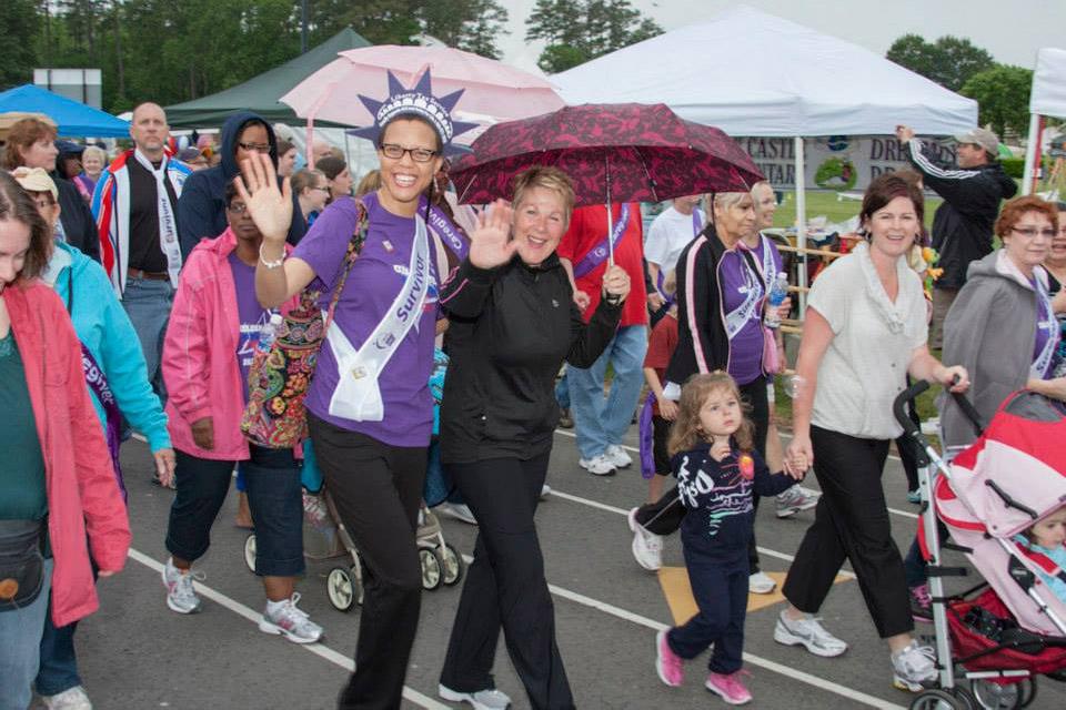 smiling women walking in a parade