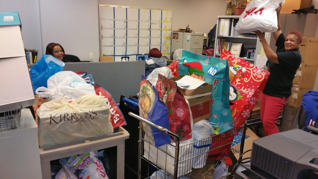 Volunteers collect Angel Tree Gifts